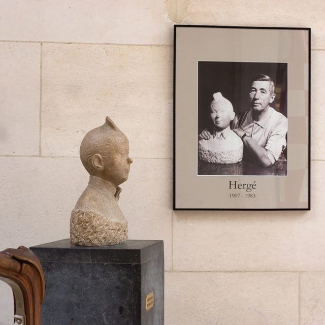portrait of Herg with the Tintin sculpture next to thehellip