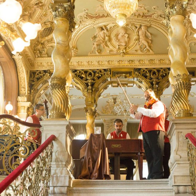 musicians play for the AfternoonTea guests at NewYorkPalace in Budapest